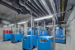 """<div class=""""99 Bildunterschrift"""">In der zweistöckigen Druckluftzentrale wurden die vier Kompressoren mit je 20 Nm<sup>3</sup>/min mit WRG ausgestattet.</div>"""