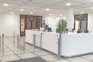 Nach der Fertigstellung des 1. Bauabschnitts: Im Foyer des Bürogebäudes mussten die neuen, hellen Deckensegel besondere Brandschutzvorgaben erfüllen.