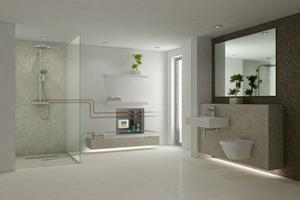 Das Sanftläufer-System wird hinter einer Revisionsklappe in die Badezimmerwand eingebaut. Das führt zu niedrigen Bodenaufbauten bei barrierefreien Duschplätzen.