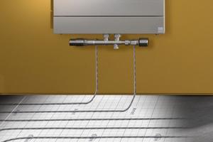 """Die """"x-link plus""""-Anschlussgarnitur ermöglicht die Anbindung über den 50-mm Anschluss der Kompakt-Badheizkörper, hier der """"Tabeo"""" mit """"x-link plus"""" Anschlusssituation ohne Blende und """"x-net C16 clip""""-System."""